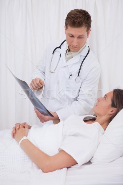 Doctor explaining x-ray to bedridden patient Stock photo © wavebreak_media