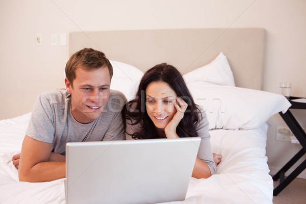 Young couple using laptop on the bed together Stock photo © wavebreak_media