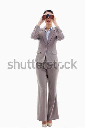 Portrait of a businesswoman looking through binoculars against a white background Stock photo © wavebreak_media