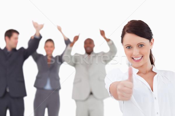 Verkoopster juichen collega's duim omhoog witte Stockfoto © wavebreak_media