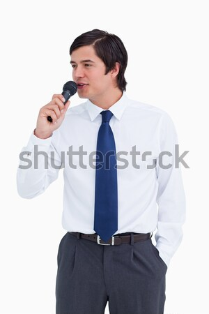 Close up of young tradesman talking with microphone against a white background Stock photo © wavebreak_media