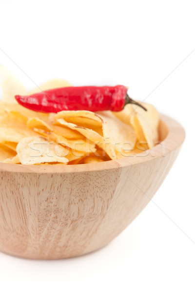 Stock photo: Pimento on a wooden bowl of chips against white background