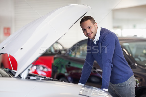 Man leaning over a car in a dealership Stock photo © wavebreak_media