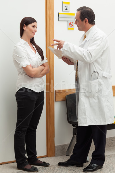 Doctor talking to a patient in a hallway Stock photo © wavebreak_media