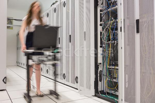 Woman pushing computer to open servers in data center Stock photo © wavebreak_media