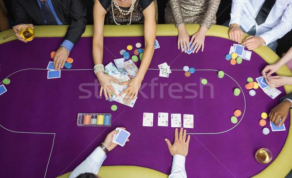 люди играет покер женщину деньги стороны Сток-фото © wavebreak_media