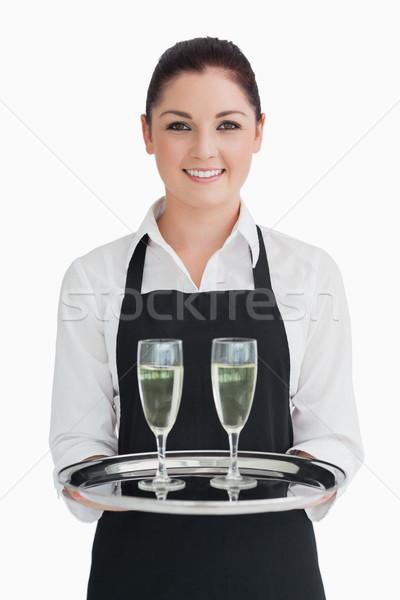 笑みを浮かべて ウエートレス トレイ シャンパン フルート ストックフォト © wavebreak_media