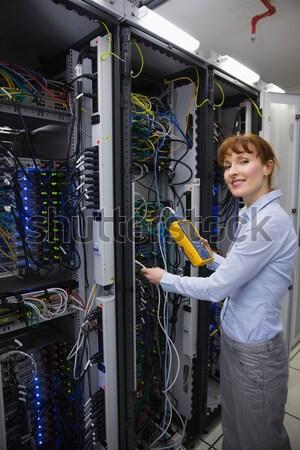Technician working on a case of server racks Stock photo © wavebreak_media