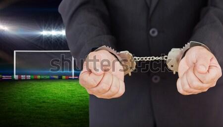 Businessman in handcuffs clenching fists Stock photo © wavebreak_media