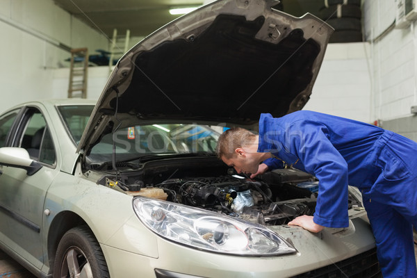 Mechanic working under car bonnet Stock photo © wavebreak_media