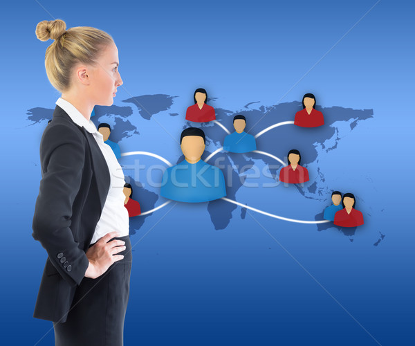 Composite image of businesswoman standing with hands on hips Stock photo © wavebreak_media