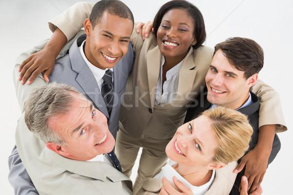 Blisko zespół firmy kółko uśmiechnięty w górę Zdjęcia stock © wavebreak_media