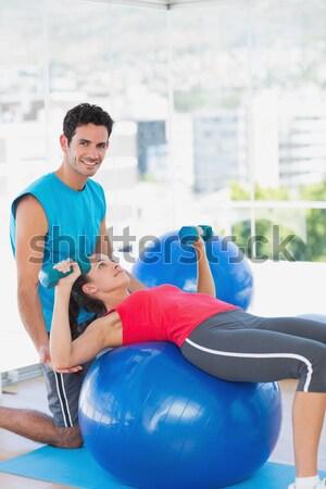 Edző segít nő tornaterem férfi fényes Stock fotó © wavebreak_media