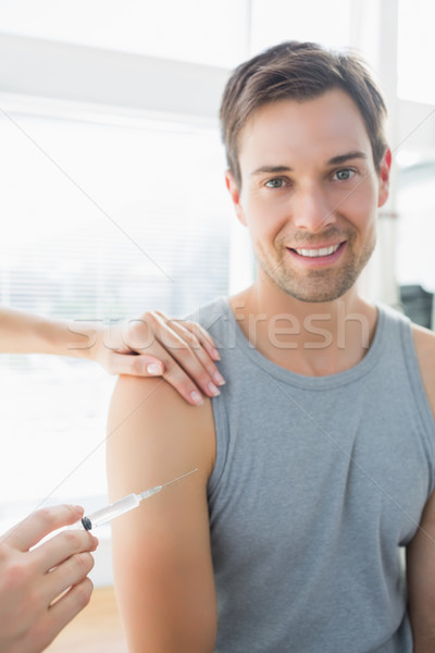 Stock photo: Happy man being injected by doctor