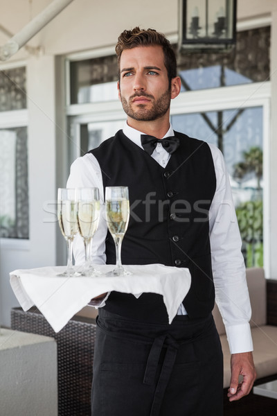 Handsome waiter holding tray of champagne  Stock photo © wavebreak_media