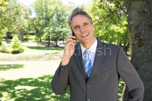 Businessman answering smart phone  Stock photo © wavebreak_media