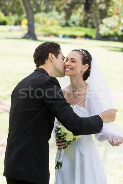 Groom kissing bride in garden Stock photo © wavebreak_media
