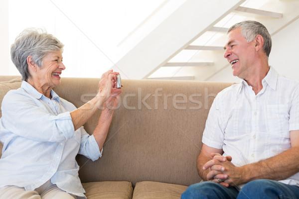 Emekli kadın fotoğraf ortak kanepe Stok fotoğraf © wavebreak_media
