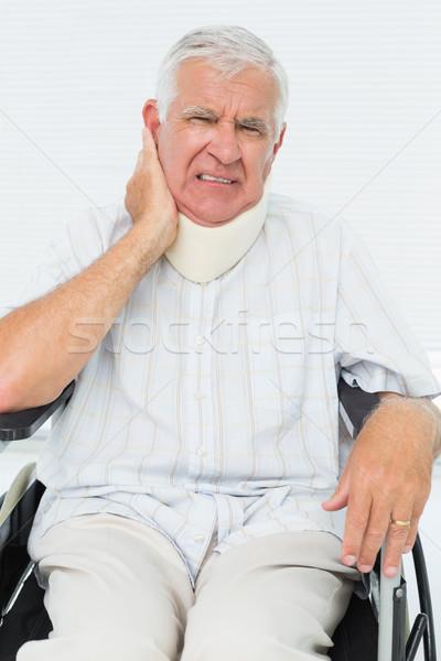 Senior man sitting in wheelchair with cervical collar Stock photo © wavebreak_media