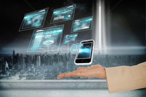 Strony smartphone digital composite kobieta dłoni Zdjęcia stock © wavebreak_media