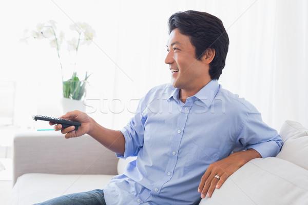 Felice uomo rilassante divano guardare tv Foto d'archivio © wavebreak_media