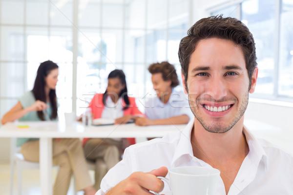 Lezser üzletember iszik forró ital iroda Stock fotó © wavebreak_media