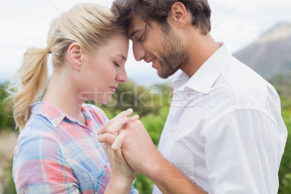 Bonitinho afetuoso casal em pé fora de mãos dadas Foto stock © wavebreak_media