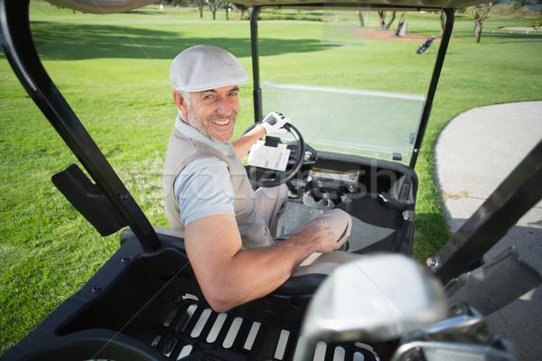 Felice golfista guida golf sorridere fotocamera Foto d'archivio © wavebreak_media