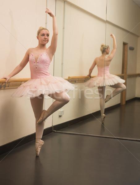 Beautiful ballerina standing en pointe with the barre Stock photo © wavebreak_media