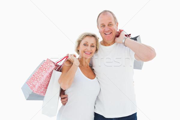 Smiling mature couple holding shopping bags Stock photo © wavebreak_media