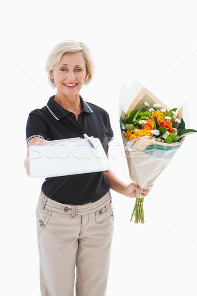 Gelukkig bloem levering vrouw naar handtekening Stockfoto © wavebreak_media