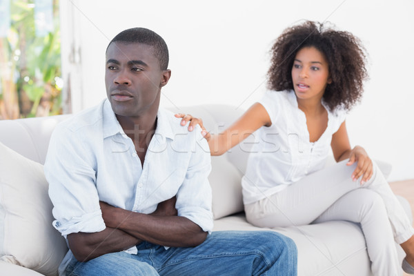 Attractive couple having an argument on couch Stock photo © wavebreak_media