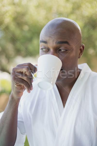 Сток-фото: красивый · мужчина · халат · кофе · за · пределами · дома