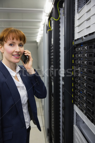 Smiling technician talking on phone while looking at server Stock photo © wavebreak_media