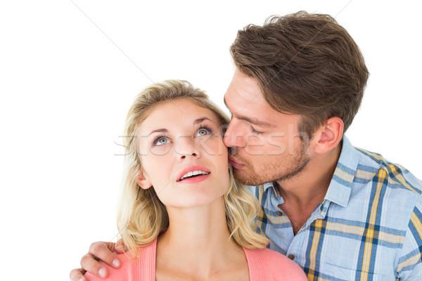Hombre guapo besar compañera mejilla blanco hombre Foto stock © wavebreak_media