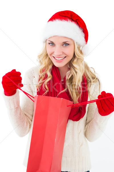 Festive blonde holding shopping bag Stock photo © wavebreak_media