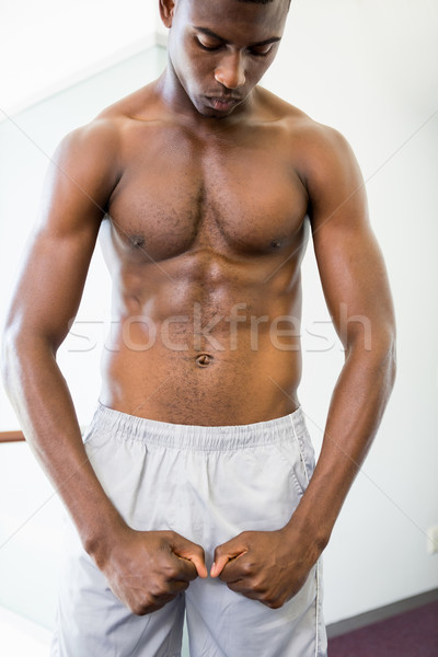 Shirtless muscular man shouting while flexing muscles Stock photo © wavebreak_media