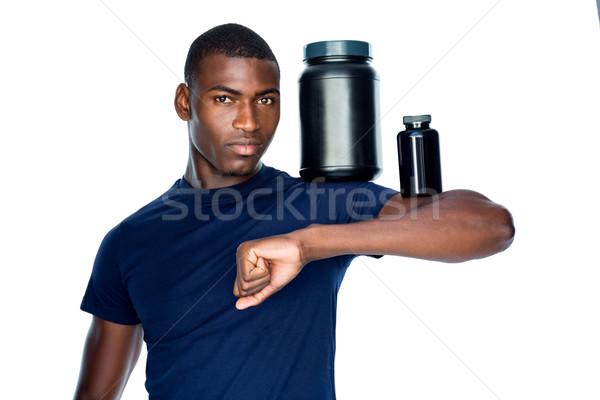 Fitt férfi tart üvegek kiegészítők bicepsz Stock fotó © wavebreak_media