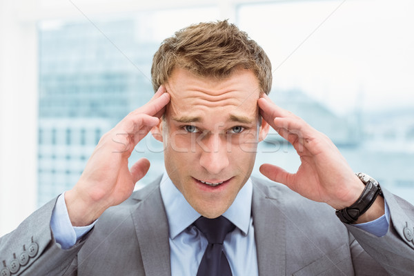 Businessman with severe headache at office Stock photo © wavebreak_media