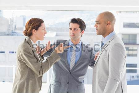 Stock photo: Business colleagues in argument at office