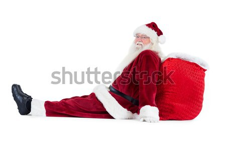 Santa sits leaned on his bag Stock photo © wavebreak_media