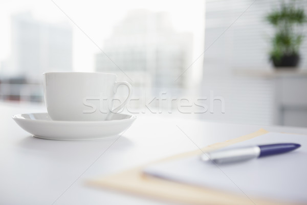 Coffee cup and saucer on desk Stock photo © wavebreak_media