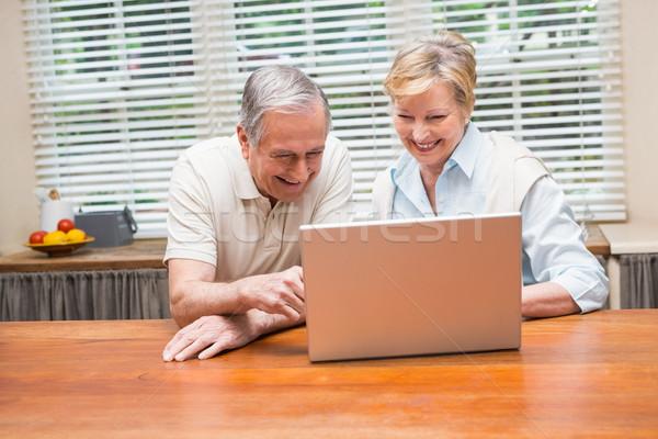 Senior couple using the laptop together Stock photo © wavebreak_media