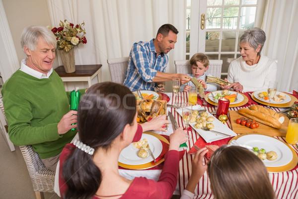 Gülen aile Noel yemek masası ev Stok fotoğraf © wavebreak_media
