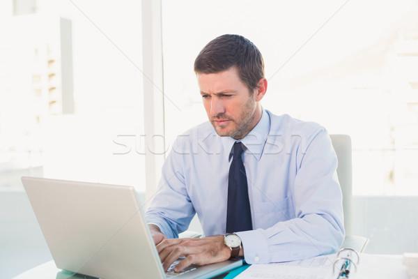Businessman using his laptop  Stock photo © wavebreak_media