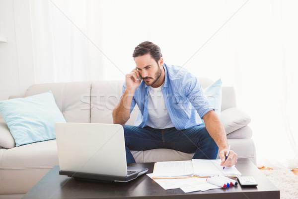 Człowiek laptop mówić telefonu Zdjęcia stock © wavebreak_media