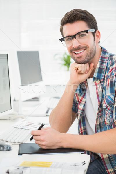 Smiling businessman using digitizer at desk Stock photo © wavebreak_media