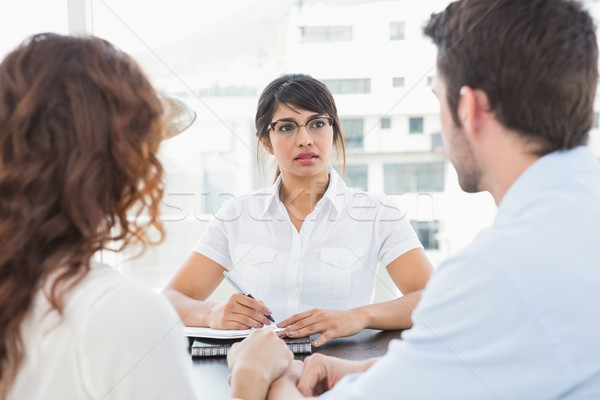 Therapist listening her patients and taking notes Stock photo © wavebreak_media
