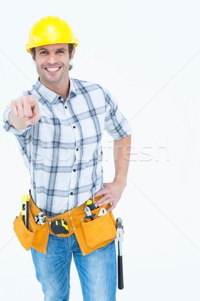 мастер на все руки указывая белый портрет счастливым человека Сток-фото © wavebreak_media