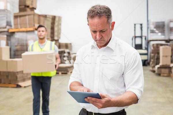 Focused boss using digital tablet Stock photo © wavebreak_media